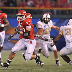 Dec 19, 2009; St. Petersburg, Fla., USA; Rutgers running back Joe Martinek (38) runs away from defenders during NCAA Football action in Rutgers' 45-24 victory over Central Florida in the St. Petersburg Bowl at Tropicana Field.