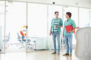 Full-length of creative businessmen conversing at office