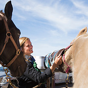 Lori Wilfcord-Herbenick, Jacksonville, waters her daughter Katana's horse Flicka, after their six day 60 mile journey though Florida's back country in the Great Florida Cattle Drive '16. <br />