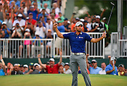 Jason Day celebrates after winning The Barclays Championship held at Plainfield Country Club in Edison, New Jersey on August 30.