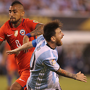 EAST RUTHERFORD, NEW JERSEY - JUNE 26: Lionel Messi #10 of Argentina falls in the penalty area and receives a booking from Brazilian referee Heber Lopes during the Argentina Vs Chile Final match of the Copa America Centenario USA 2016 Tournament at MetLife Stadium on June 26, 2016 in East Rutherford, New Jersey. (Photo by Tim Clayton/Corbis via Getty Images)