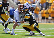 September 4 2010: Eastern Illinois Panthers tight end Cody Bruns (82) is hit by Iowa Hawkeyes cornerback Brett Greenwood (30) during the second quarter of the NCAA football game between the Eastern Illinois Panthers and the Iowa Hawkeyes at Kinnick Stadium in Iowa City, Iowa on Saturday September 4, 2010. Iowa defeated Eastern Illinois 37-7.