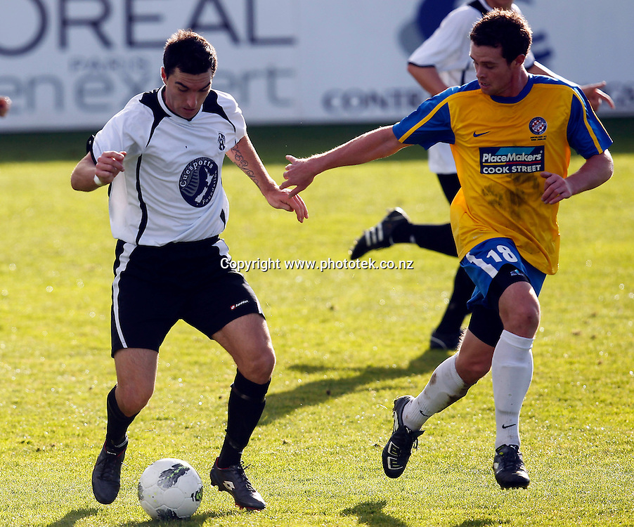 Waitakere's Jake Butler dances with Central's Adam McGeorge. 2012 Chatham Cup, Third Round, Central United v Waitakere City FC, Kiwitea Street Auckland, Sunday 24th June 2012. Photo: Shane Wenzlick