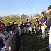 McMahon Senators coaching staff address the team after an extra inning 3-2 win during the High School Baseball ball game between Trumbull Golden Eagles and McMahon Senators at Brien McMahon High School. Norwalk, Connecticut. USA. 26th April 2012. Photo Tim Clayton