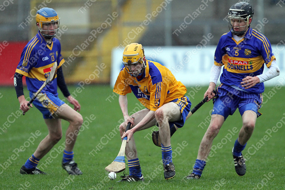 Cathal O'Connor Sixmilbridge about to gather possession surrounded by Newmarket's Thomas Griffin & Shane Kelleher. Photograph by Flann Howard