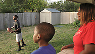 Terrence Talbott gets ready to throw a football to his brother Terry, watched by (from left) cousin Devoni'ye Benson, 6 and mother Natasha White,  Sunday August 12, 2007.