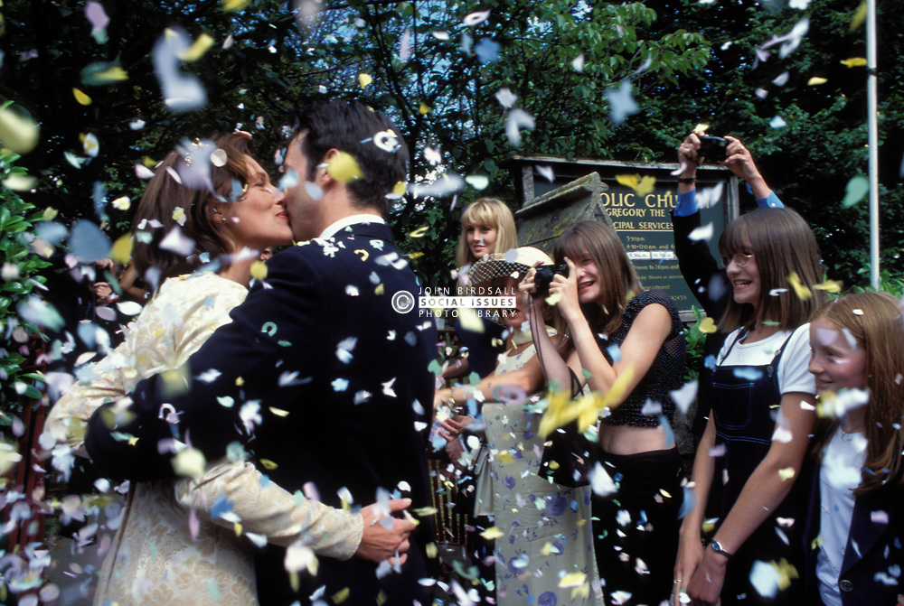 Confetti being thrown after traditional wedding; UK