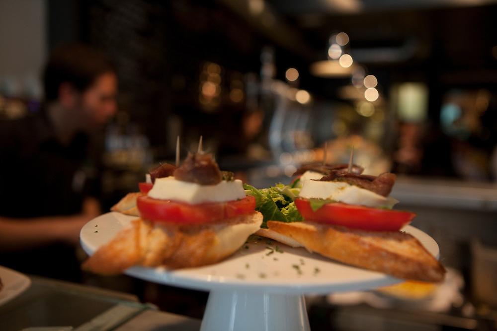 Tapas at Mercado de la Reina, a trendy and popular tapas restaurant on Gran Vía in Madrid, Spain.