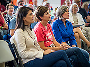 """15 JUNE 2019 - BOONE, IOWA: US Senator JONI ERNST (R-IA), right, Goveror KIM REYNOLDS (R-IA), center, and former UN Ambassador NIKKI HALEY applaud during a speech by US Senator Chuck Grassley at """"Joni's Roast and Ride,"""" an annual motorcycle ride / barbecue fund raiser hosted by Ernst. Ernst, Iowa's junior US Senator, kicked off her re-election campaign during the """"Roast and Ride"""", an annual fund raiser and campaign event has she held since originally being elected to the US Senate in 2014.    PHOTO BY JACK KURTZ"""