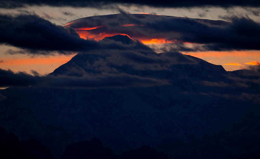The sun sets over Denali the largest mountain in North America located in Denali National Park Alaska.