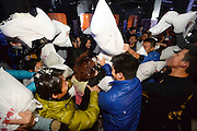 TAIYUAN, CHINA - JANUARY 07: China Out- Finland out<br /> <br /> Pillow Fight Games To Make Friends<br /> <br /> People hit each other with pillows as they take part in a pillow fight to make friends on January 7, 2014 in Taiyuan, Shanxi Province of China.<br /> ©Exclusivepix