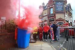 23rd August 2017 - UEFA Champions League - Play-Off (2nd Leg) - Liverpool v 1899 Hoffenheim - Liverpool fans watch as a red flare burns in a bin outside The King Harry pub - Photo: Simon Stacpoole / Offside.