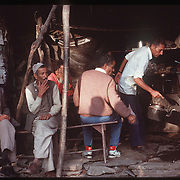 Photo by David Stephenson.  A group of Indian men drink their morning tea at a market in Dharamsala, India, in 11/91.
