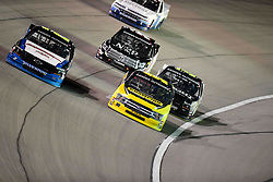 March 1, 2019 - Las Vegas, Nevada, U.S. - LAS VEGAS, NV - MARCH 01: Sheldon Creed (2) Gallagher Motor Sports (GMS) Chevrolet Silverado and Grant Enfinger (98) Curb Motorsports Ford F-150 race during the Gander Outdoors Truck Series Strat 200 race on March 1, 2019, at Las Vegas Motor Speedway in Las Vegas, NV. (Photo by David Allio/Icon Sportswire) (Credit Image: © David Allio/Icon SMI via ZUMA Press)