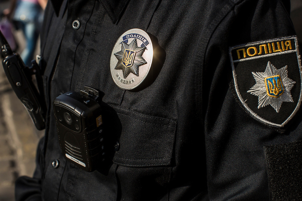 LVIV, UKRAINE - SEPTEMBER 15, 2015: The badge and body camera of Roman Katalakh, 22, a member of the new police, during a patrol Market Square, the tourist-friendly central square in Lviv, Ukraine. In an effort to reform the notoriously corrupt Ukrainian police force, an entirely new force has been established in several cities, including Kiev and Lviv, with a primary focus on patrolling the streets. CREDIT: Brendan Hoffman for The New York Times