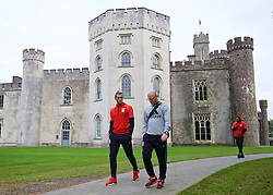 CARDIFF, WALES - Friday, October 7, 2016: Wales' Gareth Bale and physiotherapist Sean Connelly stroll past Hensol Castle during a team walk at the Vale Resort ahead of the 2018 FIFA World Cup Qualifying Group D match against Georgia. (Pic by David Rawcliffe/Propaganda)