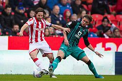 STOKE-ON-TRENT, ENGLAND - Saturday, January 25, 2020: Stoke City's captain Joe Allen (L) and Swansea City's Conor Gallagher during the Football League Championship match between Stoke City FC and Swansea City FC at the Britannia Stadium. (Pic by David Rawcliffe/Propaganda)
