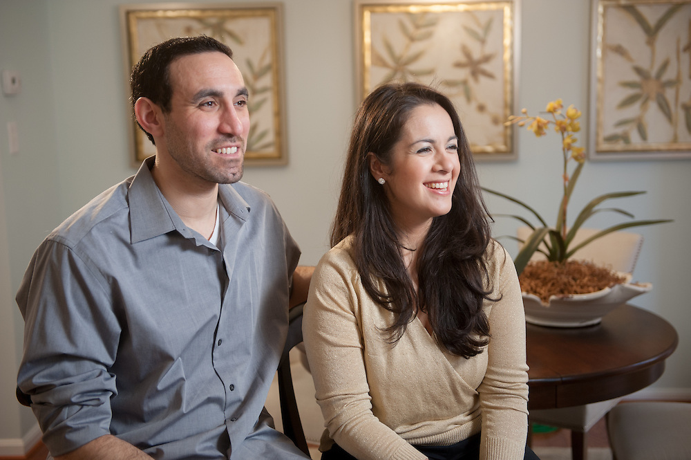 Seth and Simchah Bogin are sitting in their new dining room as seen on HGTV's House Hunters Renovation