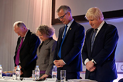 © licensed to London News Pictures. London, UK 12/04/2012. Mayoral candidates, Ken Livingstone, Jenny Jones, Brain Paddick and Boris Johnson listening prays of the Christian society at the Gourmet Theatre, before answering questions of black societies about London's future related to mayoral election in this May. Photo credit: Tolga Akmen/LNP