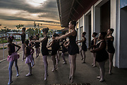 Students of the Manguinhos community ballet dance together as others are taught ballet outside a public library in Manguinhos neighbourhood, Rio de Janeiro, Brazil, Monday, June 11, 2018. The Manguinhos community ballet has been a reprieve from the violence and poverty that afflicts its namesake neighborhood for hundreds of girls who have benefitted from free dance classes since 2012. (Dado Galdieri for The New York Times)