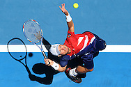 PERTH, AUSTRALIA - JANUARY 07:  Lleyton Hewitt of Australia Gold serves to Alexandr Dolgopolov of the Ukraine in the mens singles match during day five of the 2016 Hopman Cup at Perth Arena on January 7, 2016 in Perth, Australia.  (Photo by Paul Kane/Getty Images) *** Local Caption *** Lleyton Hewitt