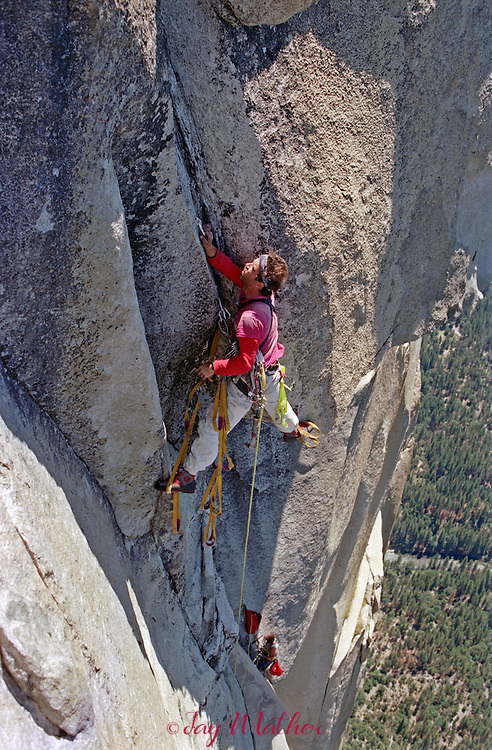 Mike Corbett leads a pitch on the Shield Route near the summit of El Capitan with Mark Wellman, July 1989.