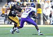 September 15 2012: Iowa Hawkeyes fullback Mark Weisman (45) eyes Northern Iowa Panthers defensive back Edwin Young (27) during the second half of the NCAA football game between the Northern Iowa Panthers and the Iowa Hawkeyes at Kinnick Stadium in Iowa City, Iowa on Saturday September 15, 2012. Iowa defeated Northern Iowa 27-16.