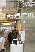 Sign in Chinese advertising the Apple iPhone and iPad at the Apple store in Beijing, China