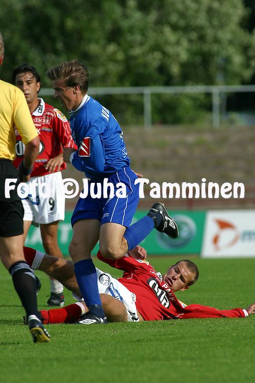 14.07.2002, Pori, Finland..Veikkausliiga 2002 / Finnish League 2002..FC Jazz Pori v Tampere United..Ilkka Santahuhta (FC Jazz) v Jussi Kuoppala (TreU).©Juha Tamminen