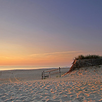 Happy Place - Cape Cod sunrise photos from Nauset Beach are available as museum quality photography prints, canvas prints, acrylic prints or metal prints. Prints may be framed and matted to the individual liking and decorating needs:<br /> <br /> http://juergen-roth.artistwebsites.com/featured/happy-place-juergen-roth.html<br /> <br /> Look deep into nature, and then you will understand everything better. Albert Einstein<br /> <br /> Cape Cod Nauset Beach sunrise photography. This most popular beach on Cape Cod is located in Orleans, MA and the Cape Cod photography image was taken minutes after sunrise when the light was painting the sky in beautiful blue and orange hues. The dunes, beach grass and fences provide an interesting compositional element in the foreground. <br /> <br /> Happy Place fine art prints are available on canvas, metal, acrylic or standard photo paper, matted, framed, or print only.<br /> <br /> Good light and happy photo making!<br /> <br /> Juergen<br /> Art Prints: https://www.RothGalleries.com<br /> Image Licensing: https://www.ExploringTheLight.com<br /> Twitter: @NatureFineArt<br /> Facebook: https://www.facebook.com/naturefineart