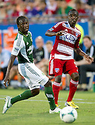 FRISCO, TX - JUNE 26:  Jair Benitez #5 of FC Dallas is defended by Diego Chara #21 of the Portland Timbers on June 26, 2013 at FC Dallas Stadium in Frisco, Texas.  (Photo by Cooper Neill/Getty Images) *** Local Caption *** Jair Benitez; Diego Chara