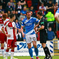 Chris Kane gets to his feet following a collision. The referee looks at this wound while Jason Holt looks on