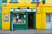 General store in Irish green and gold colour in popular tourist town of Youghal, County Cork, Ireland