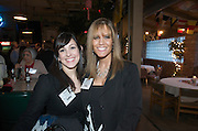 Elissa Toto with the Youngstown-Warren Regional Chamber, left, and Kimberly Gonda of the Youngstown-Warren Regional Chamber, right, during the Valley Magazine launch party at the Youngstown Crab Co. on Feb. 21, 2008.