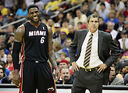 Miami Heat forward LeBron James (6) reacts to a technical foul call on Washington Wizards head coach Randy Whittman during the second half of an NBA preseason basketball game, Wednesday, Oct. 24, 2012, in Kansas City, Mo. (AP Photo/Colin E Braley)