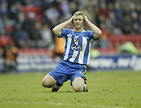Photo: Aidan Ellis.<br /> Wigan Athletic v West Bromwich Albion. The Barclays Premiership. 15/01/2006.<br /> Wigan's Graham Kavangh sees his free kick go just wide