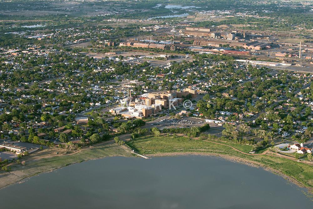Lake Minnequa, with St Mary Corwin Hospital and Evraz Steel.  Pueblo, Colorado. June 2014. 85750
