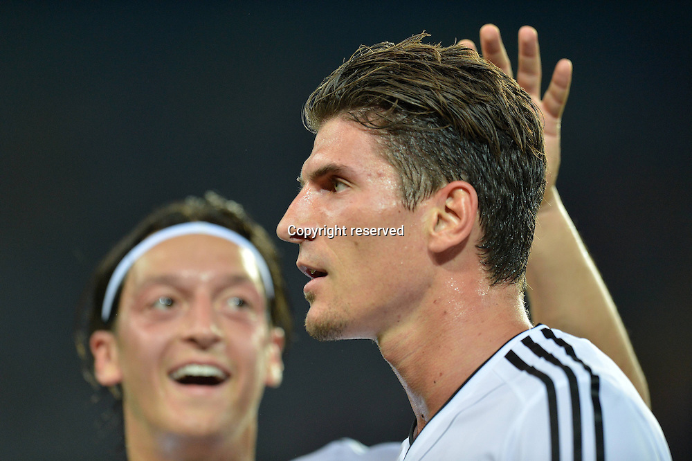 13.06.2012. Kharkiv, Ukraine.  Football European Championship 2012 Netherlands versus Germany. Mario Gomez of Germany Celebrates with Mesut Ozil After Scoring during The Group B 2nd Round Match Against Netherlands in Kharkiv Ukraine