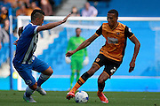Hull City defender Isaac Hayden takes on Brighton central midfielder Beram Kayal during the Sky Bet Championship match between Brighton and Hove Albion and Hull City at the American Express Community Stadium, Brighton and Hove, England on 12 September 2015. Photo by Bennett Dean.