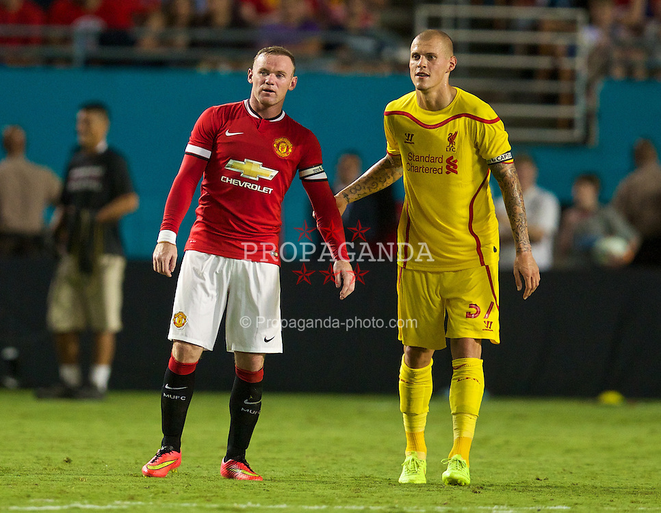 MIAMI, USA - Monday, August 4, 2014: Liverpool's Martin Skrtel and Manchester United's Wayne Rooney during the International Champions Cup Final match at the SunLife Stadium on day fifteen of the club's USA Tour. (Pic by David Rawcliffe/Propaganda)