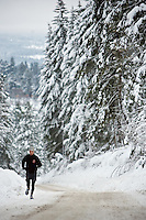 JEROME A. POLLOS/Press..Kjell Sthioeberg, a triathlete from Hamburg, Germany, strides uphill on Fairmont Loop during a 10-mile run Monday, Jan. 5.