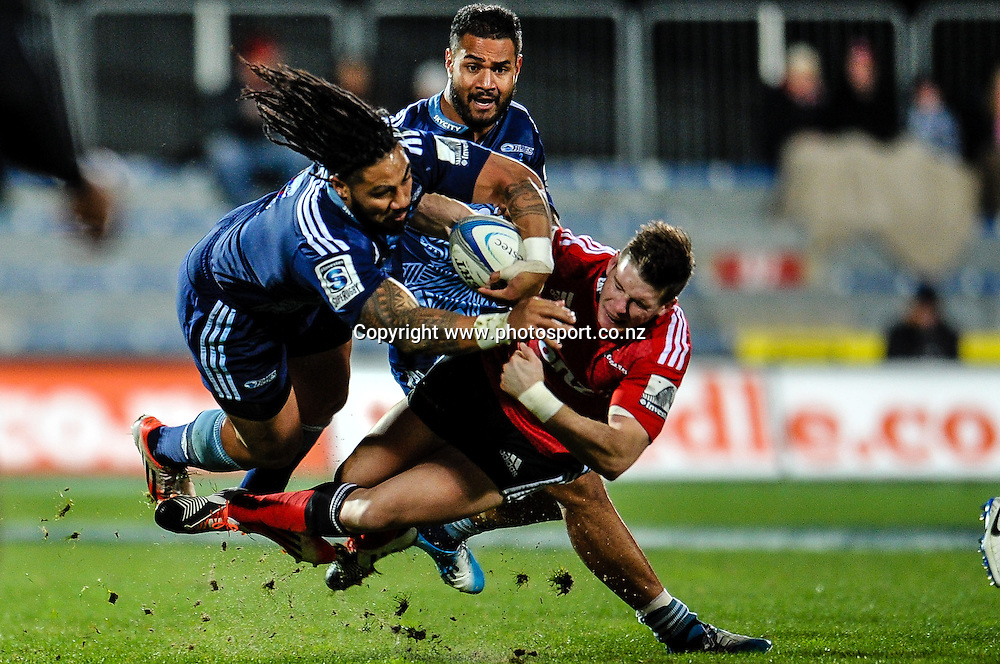 Ma'a Nonu of the Blues is tackled by Colin Slade of the Crusaders in the Super rugby  match,  Crusaders v The Blues, at AMI Stadium, Christchurch, on the 5 July 2014 . Photo:John Davidson/www.photosport.co.nz