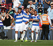 Charlie Austin (QPR striker) celebrating scoring with Matt Phillips (QPR midfielder) and Tjaronn Chery (QPR midfielder) during the Sky Bet Championship match between Queens Park Rangers and Rotherham United at the Loftus Road Stadium, London, England on 22 August 2015. Photo by Matthew Redman.