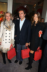 Left to right, SAHA HASHEMI, her brother BOBBY HASHEMI and PHILINE DUMBA at Garrard's Winter Wonderland party held at their store 24 Albermarle Street, London W1 on 30th November 2006.<br />