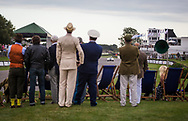 Motor sport enthusiasts dressed in vintage clothing watch the Kinrara Trophy Race at the Goodwood Revival in Chichester, England   Friday, Sept. 9, 2016 The historic motor racing festival celebrates the mid-20th-century golden era of the racing circuit and recreates the atmosphere from the 1950s and 1960s.(Elizabeth Dalziel)