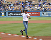 Jun 13, 2018; Los Angeles, CA, USA; Kendall Ellis runs towards home plate during a ceremonial relay before a MLB game between the Texas Rangers and the Los Angeles Dodgers at Dodger Stadium. Ellis ran the anchor leg on the Southern California Trojans women's 4 x 400m relay that won the NCAA title in the final even to win  the national team title.