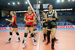 Belgium and Japan shake their hands before the match