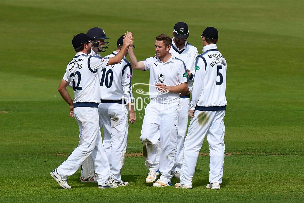 Wicket - Liam Dawson of Hampshire celebrates taking the wicket of Ben Foakes of Surrey who was caught by James Vince of Hampshire during the Specsavers County Champ Div 1 match between Hampshire County Cricket Club and Surrey County Cricket Club at the Ageas Bowl, Southampton, United Kingdom on 6 September 2017. Photo by Graham Hunt.