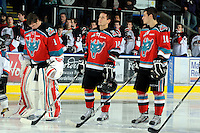 KELOWNA, CANADA, OCTOBER 26:  Adam Brown #1, Cody Chikie #14 and Filip Vasko #10 of the Kelowna Rockets line up as the Prince George Cougars visit the Kelowna Rockets  on October 26, 2011 at Prospera Place in Kelowna, British Columbia, Canada (Photo by Marissa Baecker/Shoot the Breeze) *** Local Caption *** Adam Brown; Cody Chikie; Filip Vasko;
