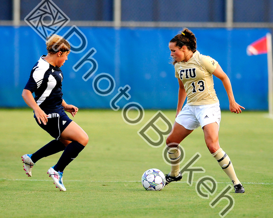 2011 August 27 - FIU Marie Egan (13) driving the ball down field. Florida International University Golden Panthers defeated Arkon Zips 1-0 at FIU Soccer Complex, Miami, Florida. (Photo by: www.photobokeh.com / Alex J. Hernandez)